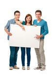 Groep tienerjaren met een banner Stock Fotografie
