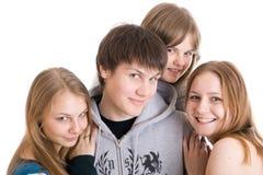 Groep tieners die op een wit worden geïsoleerde Stock Fotografie