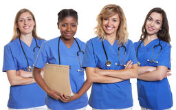 Groep van vier verpleegsters stock foto's