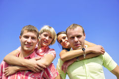 Groep van vier vrienden stock foto's
