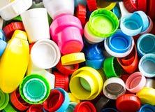 Groep vele types van plastic kleurrijke kappen royalty-vrije stock afbeelding