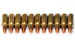 Groepeer verscheidene geweerpatronen met bezinningen Stock Foto's