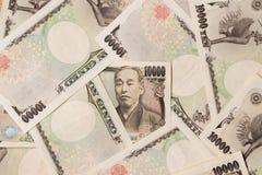 Groeps Japans bankbiljet 10000 Yenachtergrond stock foto's