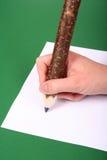 Großer Bleistift in der Hand Lizenzfreie Stockbilder