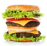 Großer königlicher appetitanregender Burger, Hamburger, Cheeseburgernahaufnahme auf einem weißen Hintergrund Stockbild