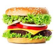 Großer königlicher appetitanregender Burger, Hamburger, Cheeseburgernahaufnahme lokalisiert Lizenzfreie Stockfotografie
