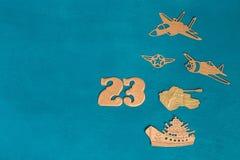 Groetkaart gedateerd 23 Februari Militaire helikopter, vliegtuig, tank, schip royalty-vrije stock afbeelding