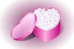 Groetkaart in gevoelige kleur met een doos en de parels van de hartvorm royalty-vrije stock afbeeldingen