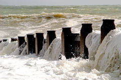 Groins Beach, UK. Waves breaking over old pilings, Groins Beach, UK Royalty Free Stock Image