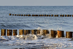Groins and waves Royalty Free Stock Photography