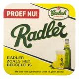 Grolsch有广告的啤酒席子Radler啤酒的 图库摄影