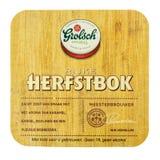Grolsch Herfstbok beermat bakgrund isolerad white Royaltyfria Bilder