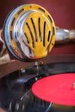 Gromophone speaker on vinyl disk close up Stock Image