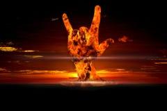 Grondement nucléaire avec le signe d'amour en main Photographie stock
