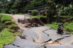 Grondverschuivingsnasleep flashflood in Kelantan, Maleisië Stock Foto's