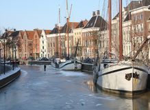 Boats in frozen canal Royalty Free Stock Photo