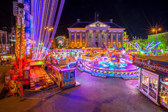 Groningen funfair. GRONINGEN, THE NETHERLANDS-MAY 5,2015: Annual Funfair during may holidays on the Grote Markt cenral city square. Long exposure image at night Stock Photo