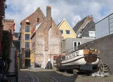 Old wooden sailing bessel in back yard of shipping museum in Groningen Stock Image