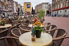Cafe tables and chairs outdoors in a Dutch shopping square stock photography