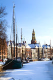Groningen in snow. View on the channel with ships in Groningen, Netherlands, during winter Royalty Free Stock Images