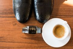 Groom's accessories: black shoes, watch, coffee. Morning Royalty Free Stock Photo