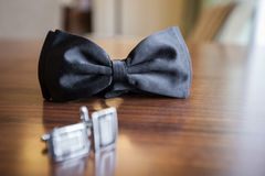 Groom accesories. Bow tie and cufflinks Royalty Free Stock Photo