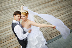 Groom adn bride for walk on embankment river. Happy groom adn bride for walk on embankment of Moscow River stock photo