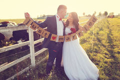 Groom And Bride Holding Just Married Letters Stock Image