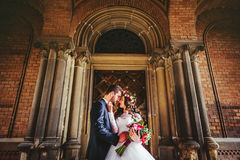 Free Groom And Bride Near The Doors Royalty Free Stock Image - 76892966