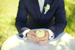 Groom with an apple Royalty Free Stock Images