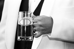 Groom with beer Stock Images