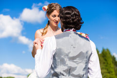 Groom begging bride for mercy Royalty Free Stock Photography