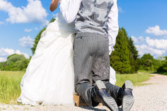 Groom begging bride for mercy Royalty Free Stock Images