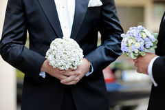 Groom and a bestman holding flowers Royalty Free Stock Images