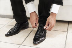 Groom black shoes Stock Photography