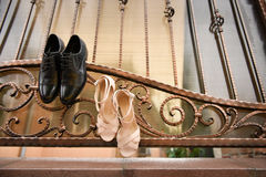 Groom black shoes and white shoes. Hanging in a wrought iron fence Stock Photography