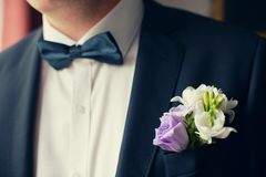 Groom in black suit with flower buttonhole Stock Photo