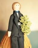 Groom. Blond groom doll in smoking Stock Photo