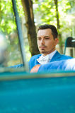 Groom in Blue Car. Groom sitting in old blue car Royalty Free Stock Image