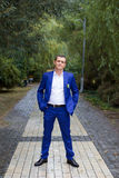 The groom in a blue suit royalty free stock photography