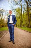 Groom in a blue suit Stock Photography