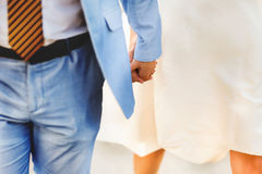 Groom in blue suit holding a bride in a white dress Royalty Free Stock Photo