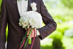 The groom with   bouquet Royalty Free Stock Image