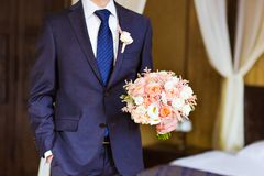 The groom with   bouquet Stock Photos