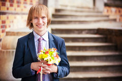 Groom with a bouquet of flowers Royalty Free Stock Image