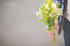 The groom with a bouquet Stock Photography