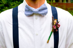 Groom Bowtie Fashion. Fashion detail image of a groom wearing a bowtie on his wedding day Royalty Free Stock Photo
