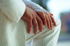 Groom and bride. Hands of groom and bride with golden wedding rings Royalty Free Stock Photo