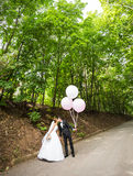 Groom  and bride  with balloons Royalty Free Stock Photography