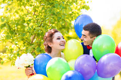 Groom  and bride  with balloons Royalty Free Stock Photos